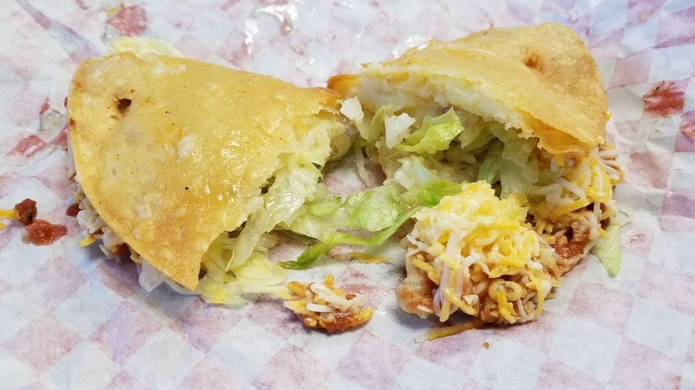 Photo of Pura Vida Mexican Food - Carson, CA, United States. Potato taco. Hot and crispy! Add the green salsa for a delicious kick!