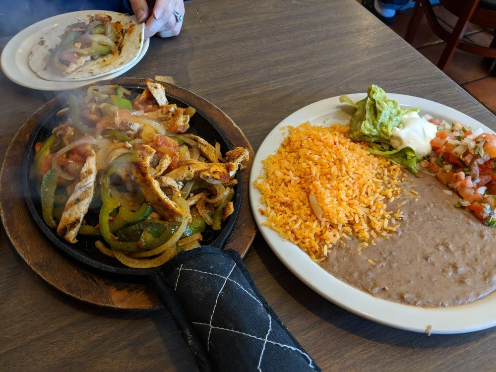 Photo of Herrera's Cafe - Dallas, TX, United States. Chicken fajitas, this is an order for one but can feed two for sure!!  Steaming hot!!
