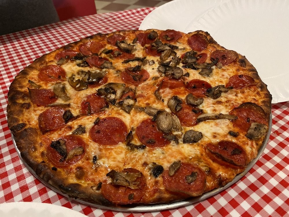 """Photo of Giovanni's Pizzeria - Albuquerque, NM, United States. 12"""" cheese pizza with pepperoni and mushrooms"""