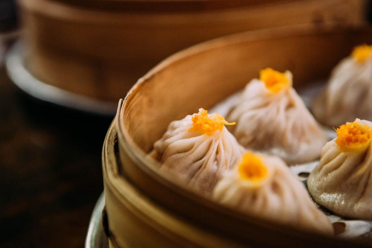 May be an image of dim sum and indoor
