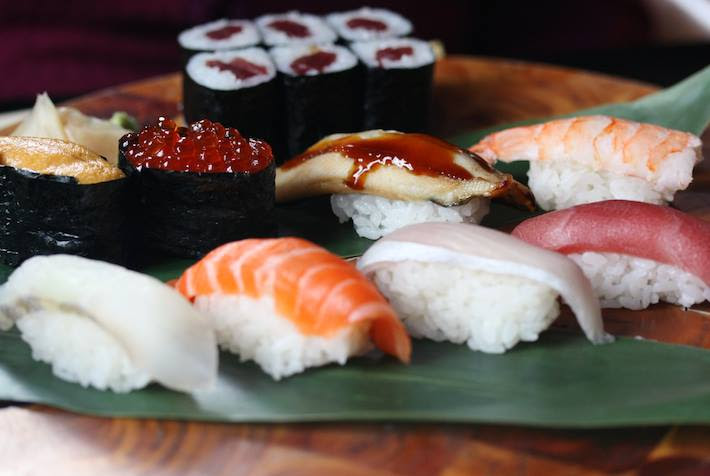 May be an image of sashimi and sushi