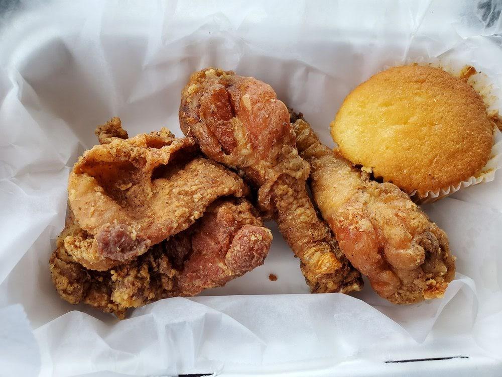 Photo of Mama J's Kitchen - Richmond, VA, United States. Fried chicken, dark w/ cornbread muffin