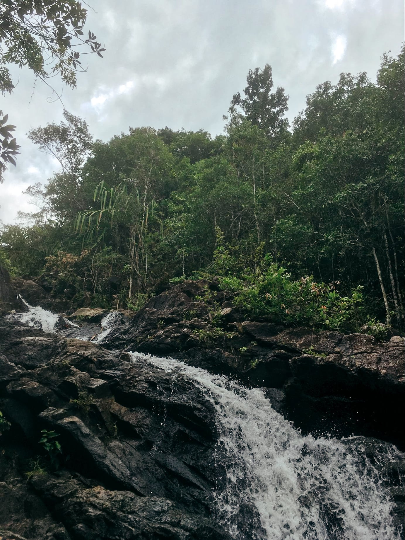 exploring a waterfall in koh phangan, thailand