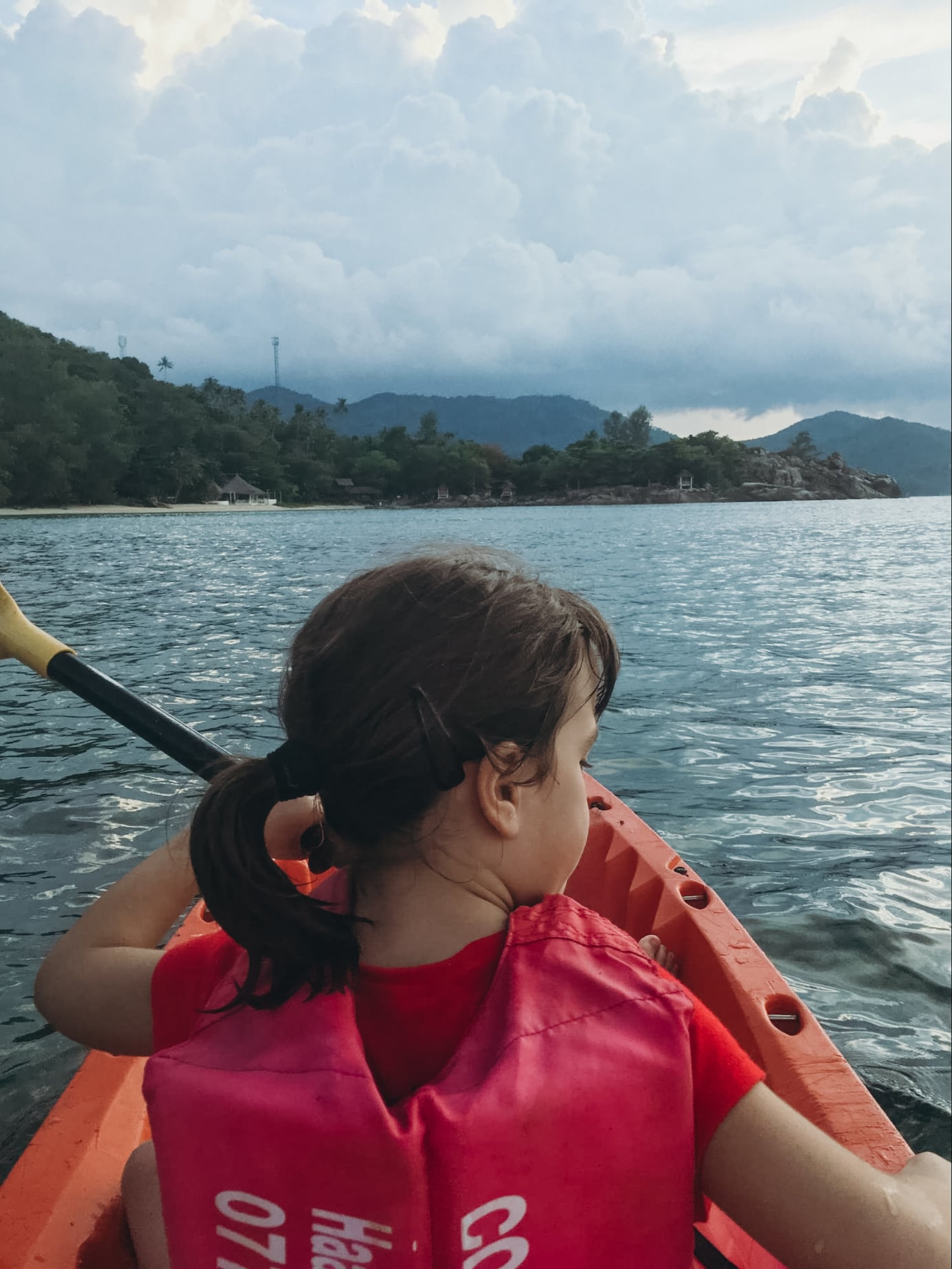 young girl kayaking in koh phangan, thailand