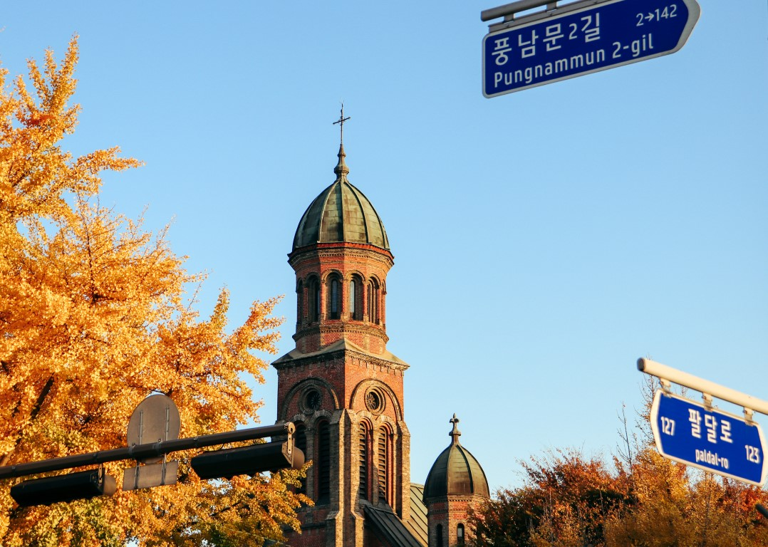 a western style church with fall leaves in jeonju, korea
