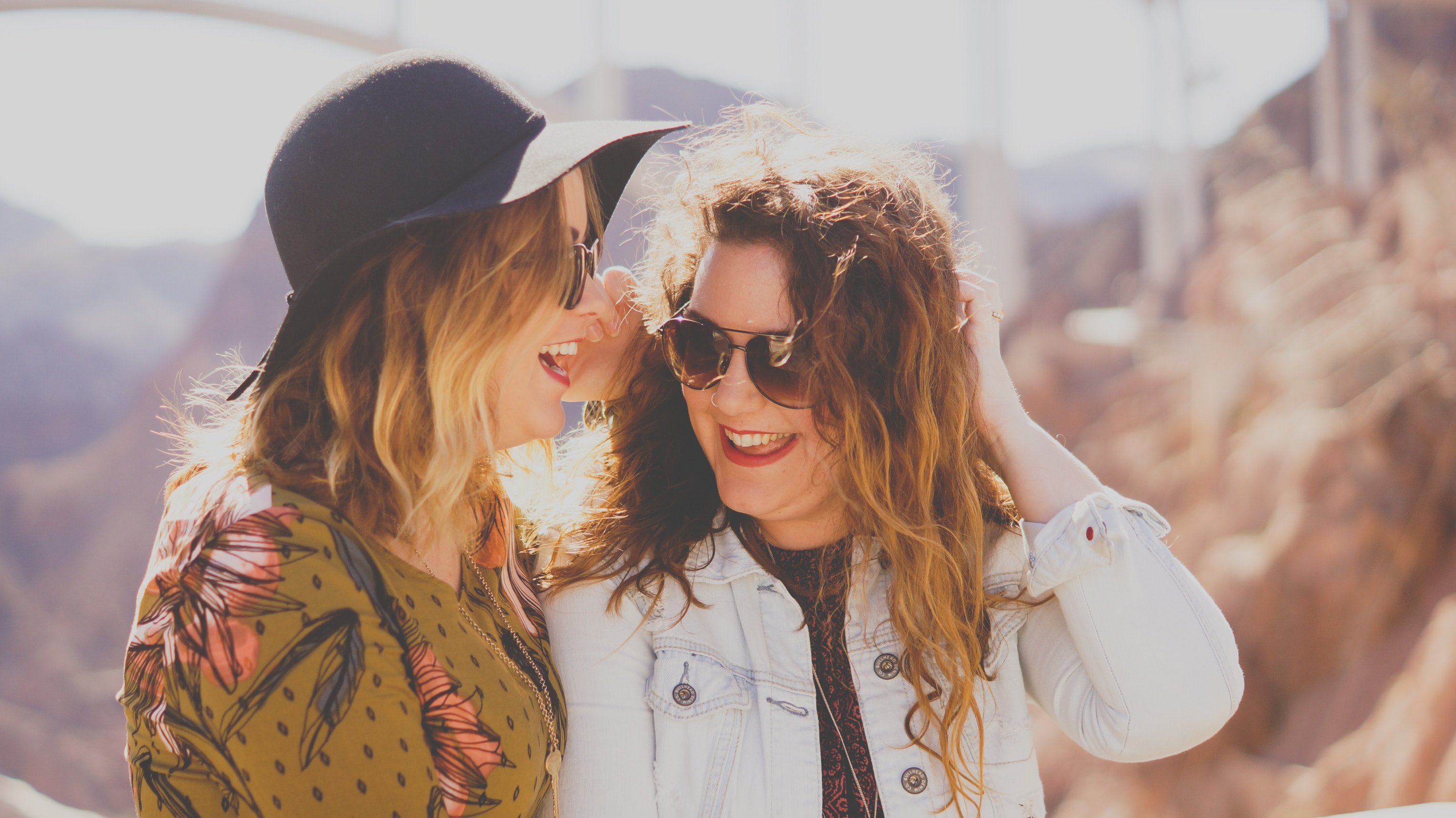 two happy women laughing together