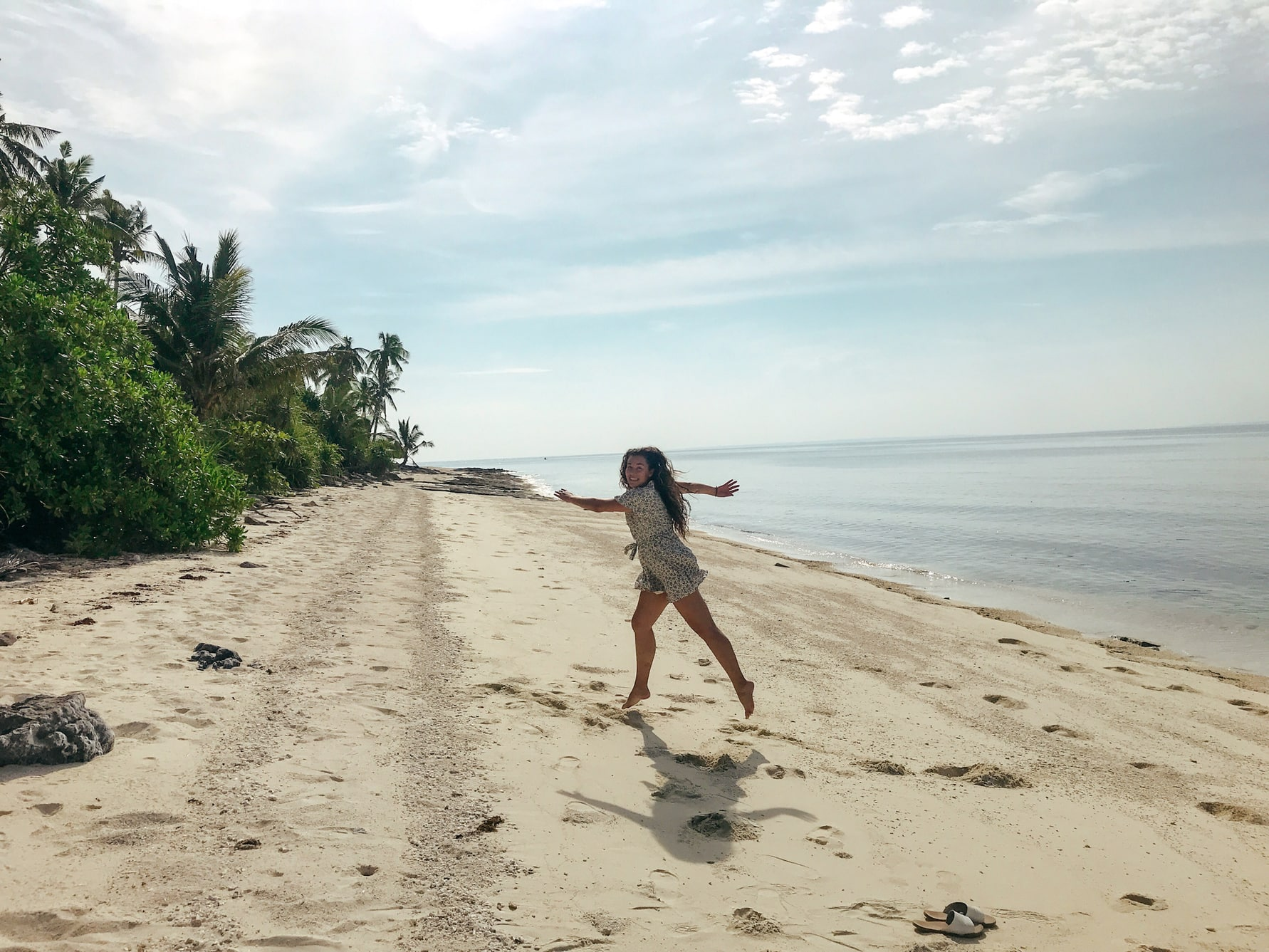 Happy girl running at Kalanggaman, Philippines