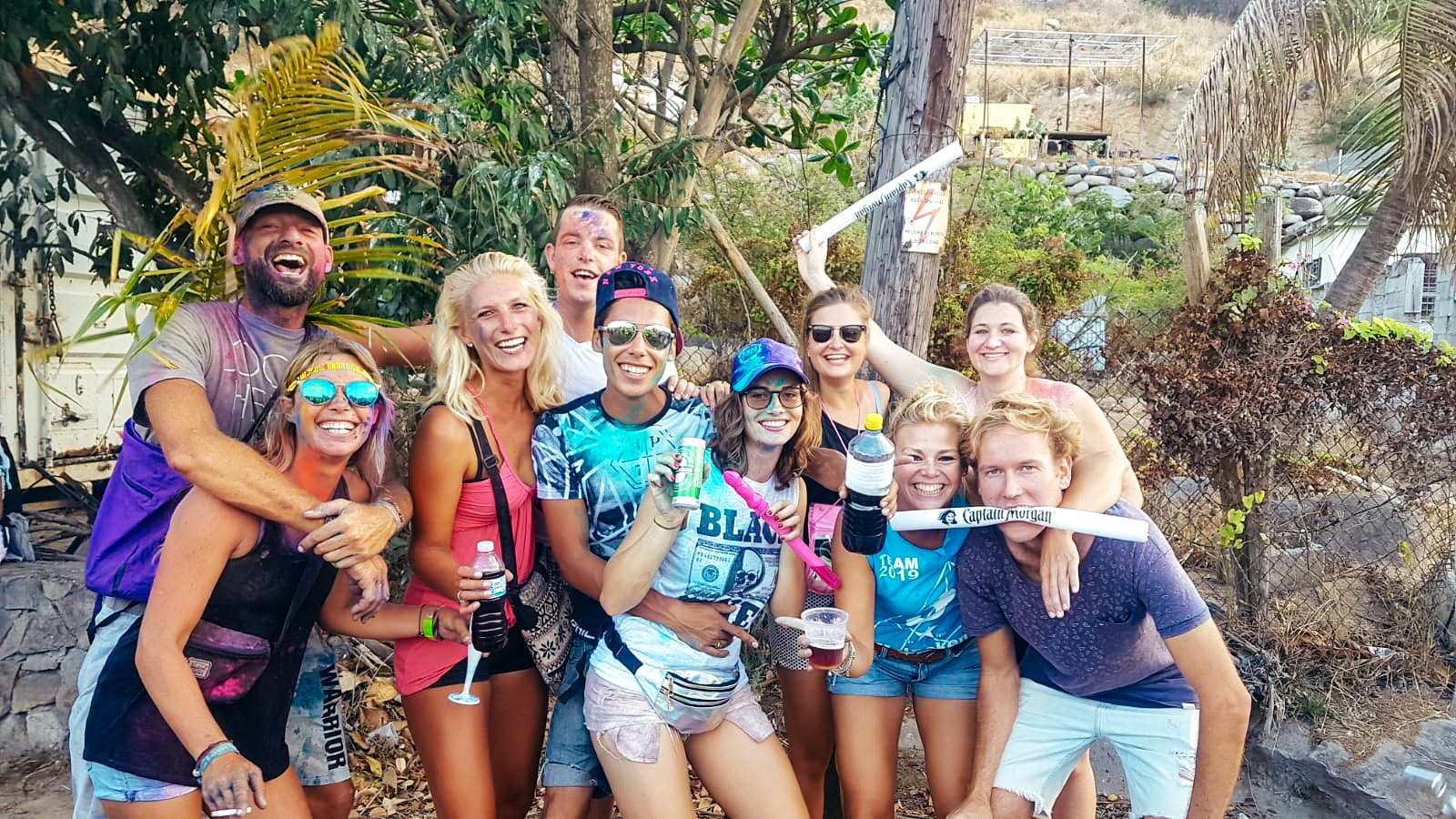 A group of friends splattered in paint having a fun day on Sint Maarten island