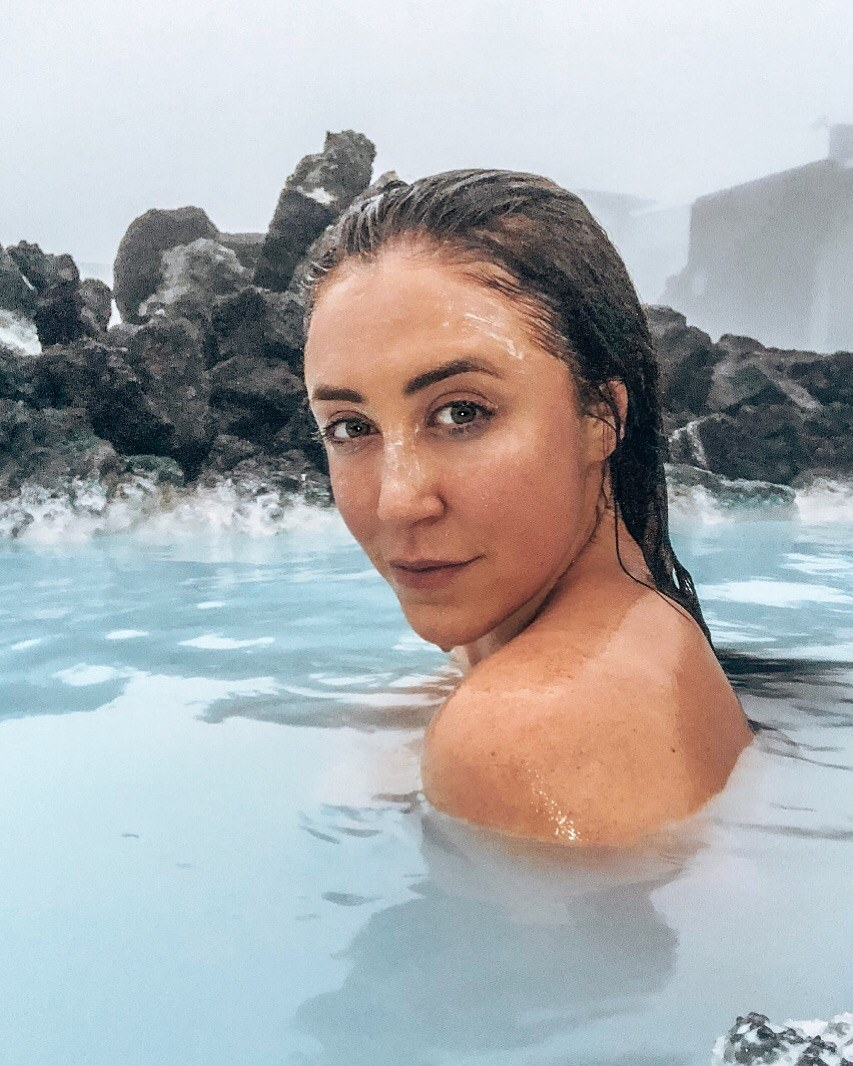 Woman bathing in the thermal pools in Iceland on a solo vacation