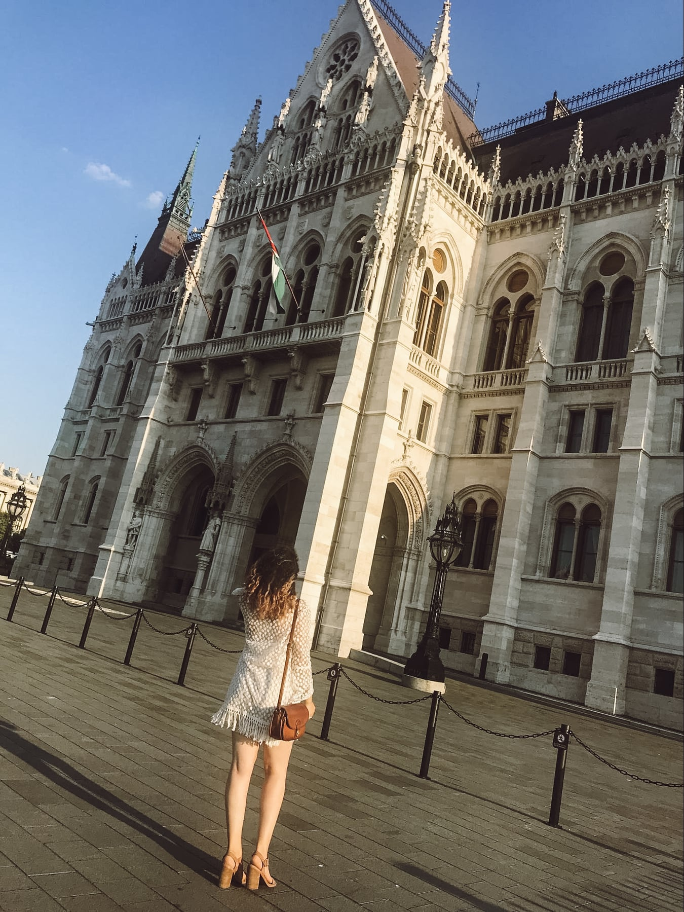 Woman in Budapest lookng at the gothic architecture