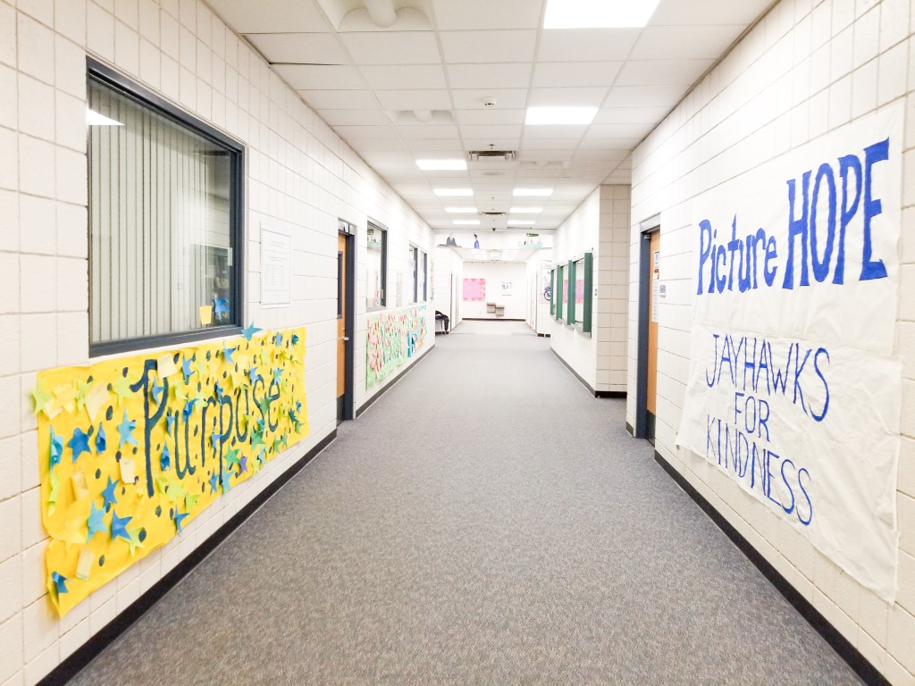 the white hallways with hand painted banners in my elementary school