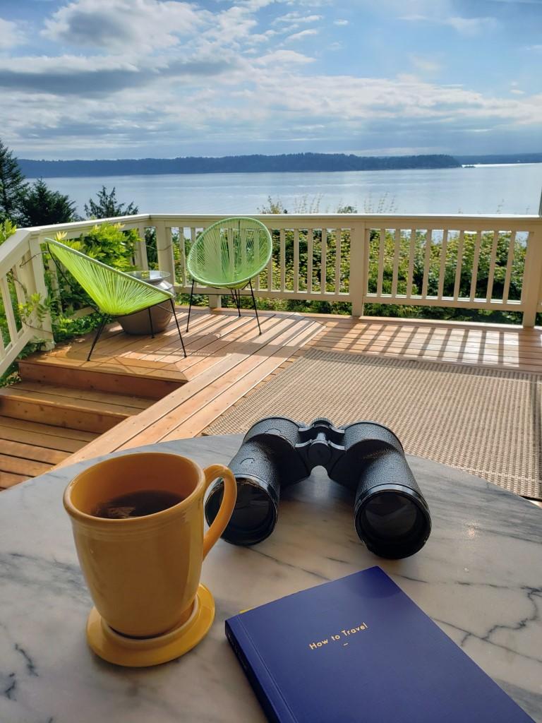 Enjoying the sea view with a morning coffee and binocularss