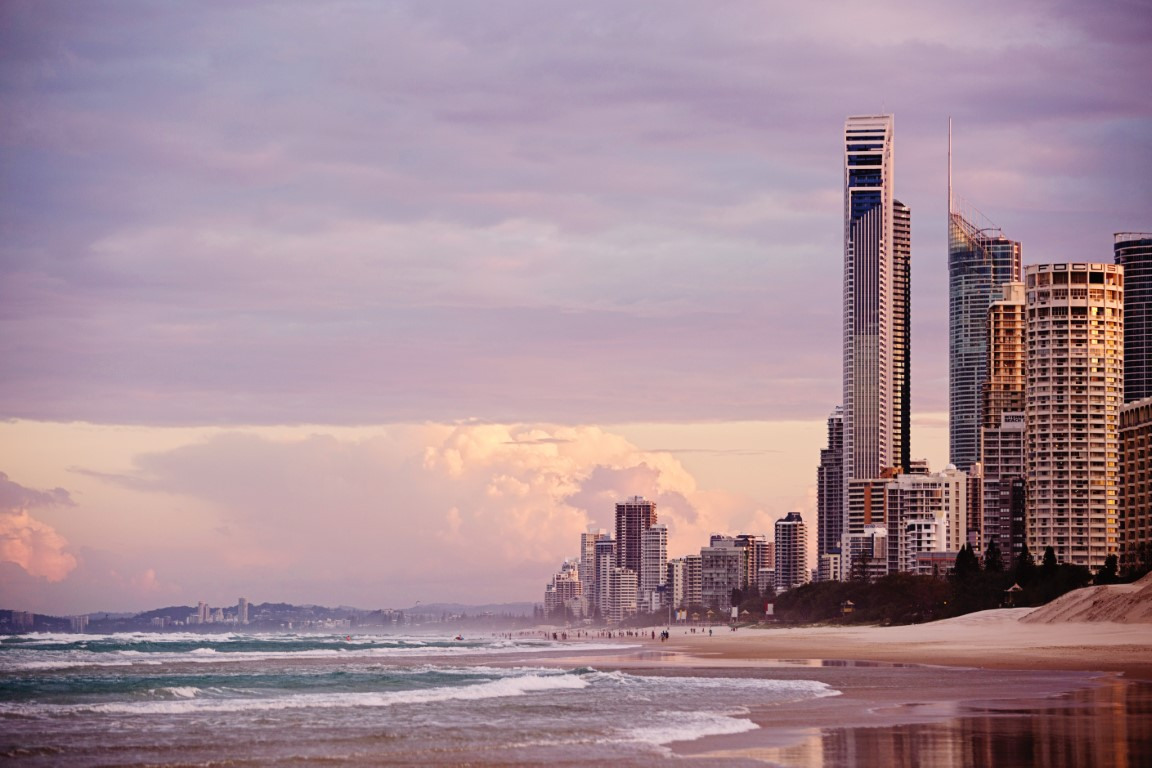 Beautiful view of the beach and highrise coastline on The Gold Coast at sunset