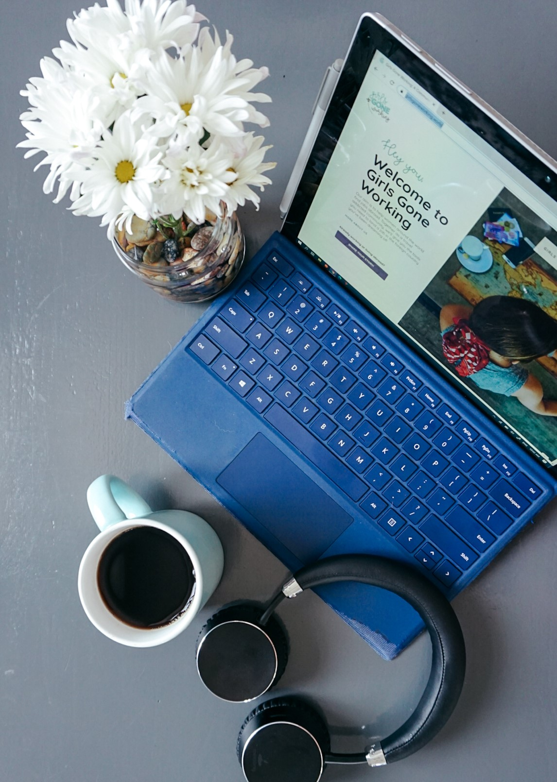 flatlay image of flowers, laptop, headphones and coffee- the basics to starting your online career!