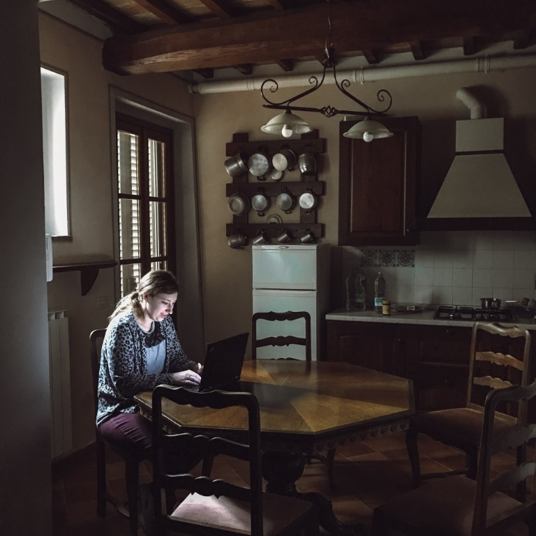 American expat working from home in her kitchen in Florence, Italy