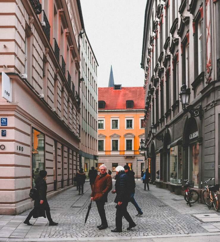 Beautiful street in ermany with pedestrians walking by