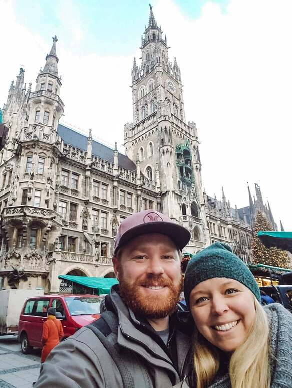 Happy American couple taking a selfie in front of gothic architecture church