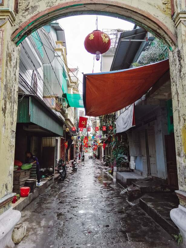 Small town alley in Vietnam with lanterns and Vietnamese flags