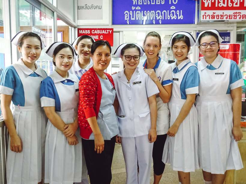 An international travel nurse with her co-workers in Thailand