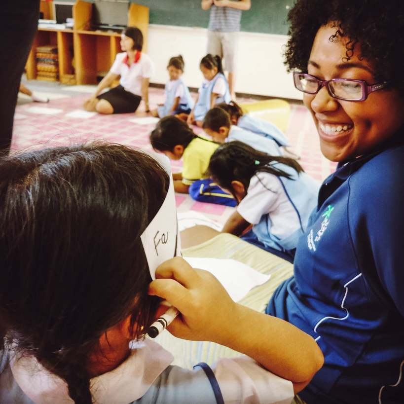 An English teacher in Phuket, Thailand playing a game with her students.