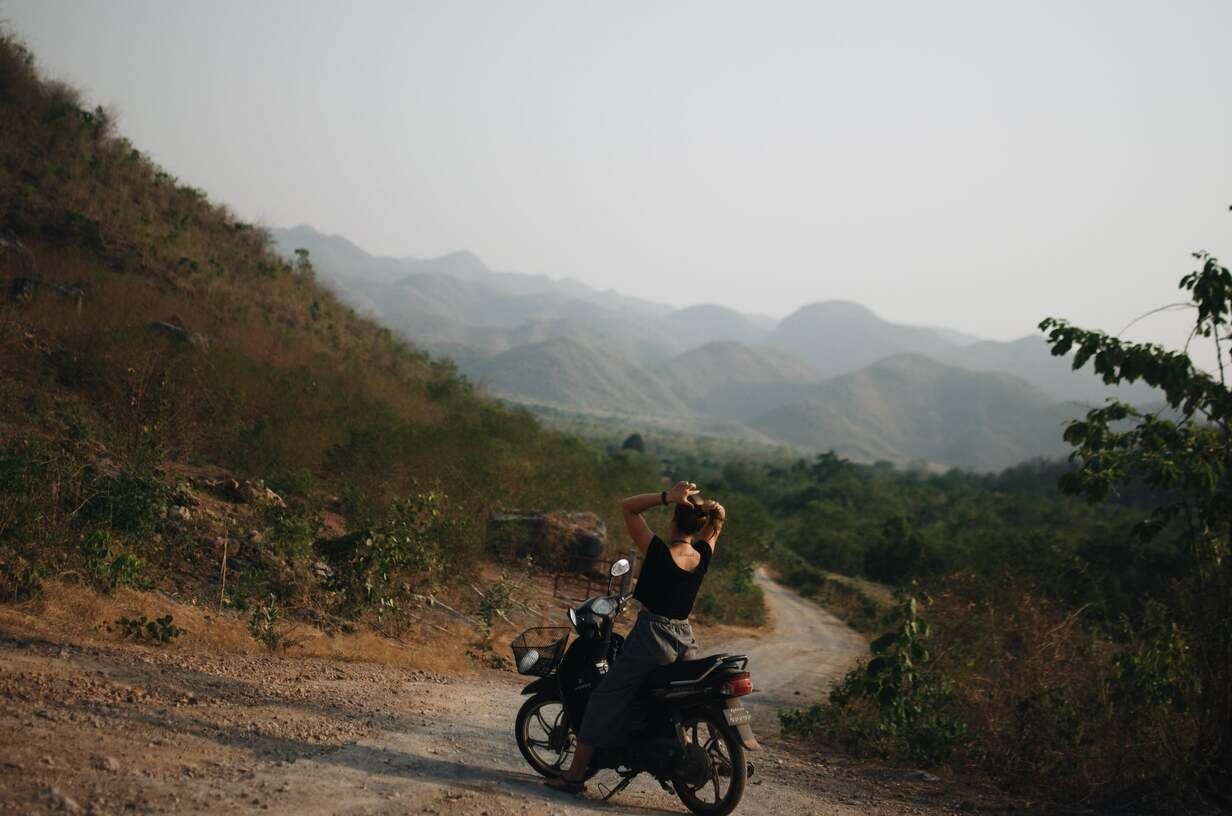 Foreigner in Myanmar riding a motorbike in the countryside