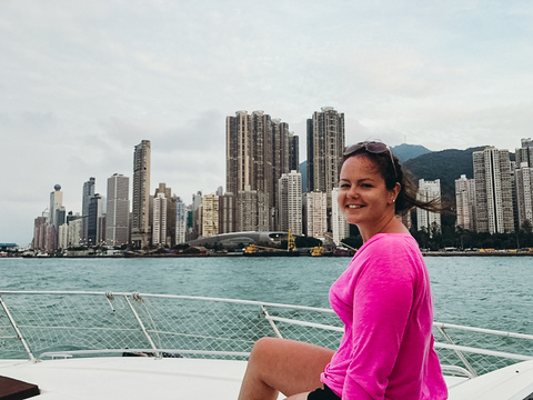 A female English teacher in Hong Kong enjoying her day off by exploring the city by boat