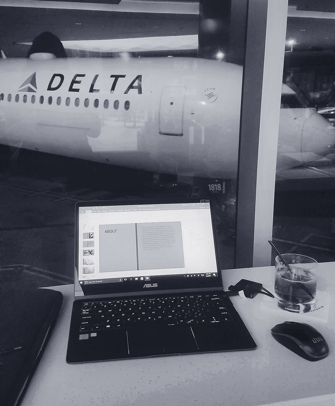 Working from the Delta lounge with airplane in background