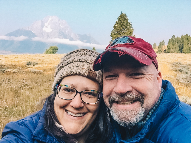 A happy couple taking a selfie at Grand Teton National Park