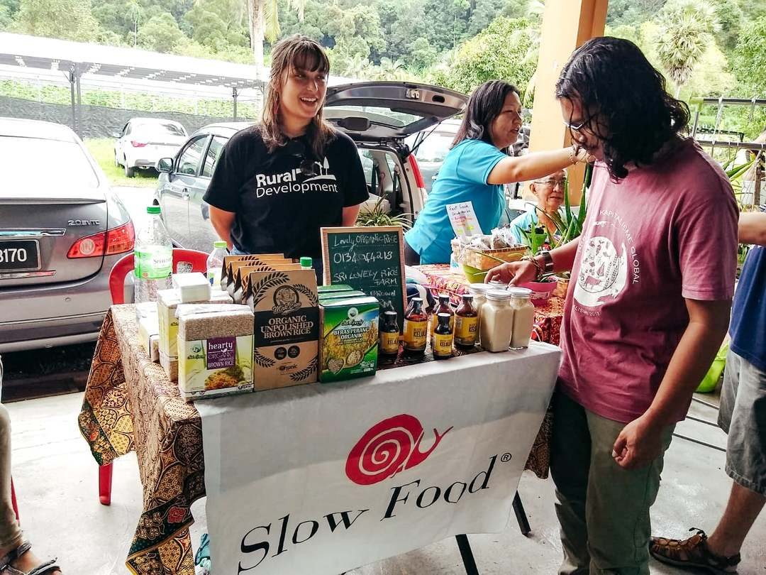 Female volunteer working for Slow Food in Malaysia at a pop up store