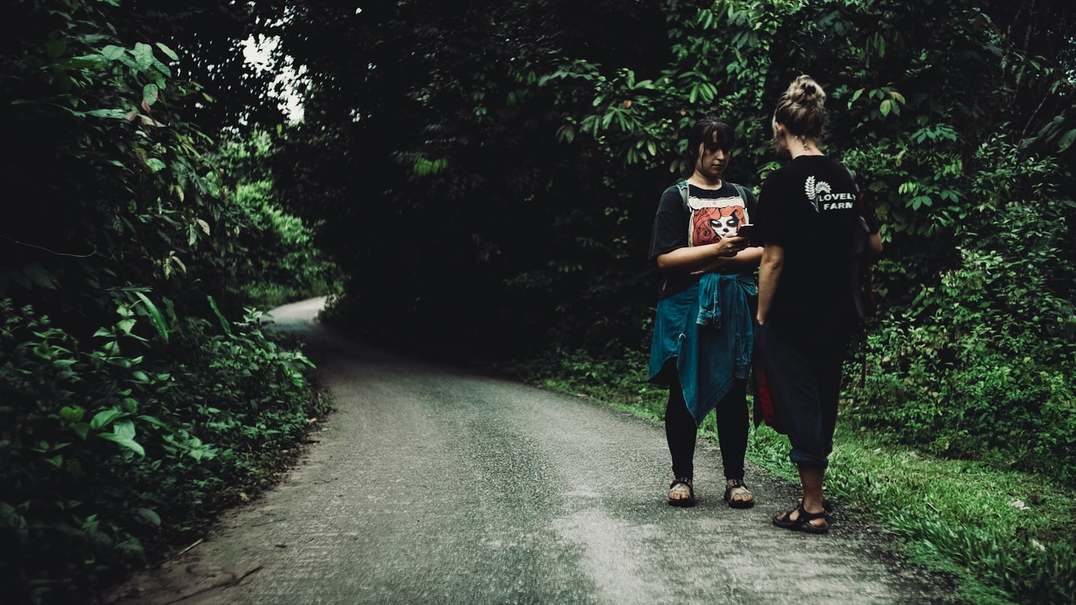 New women walking down a path in the jungle of Malaysia