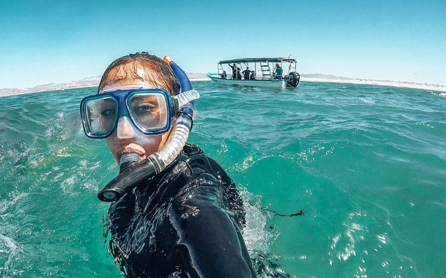 A spring break destination rep snorkeling in Mexico