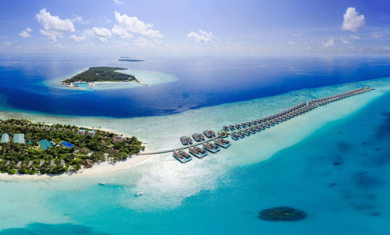 An aerial view of one of the many luxurious over water bungalow resorts in the Maldives
