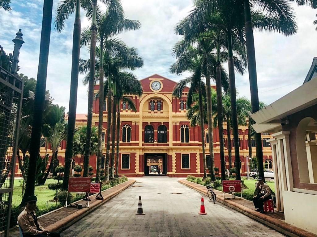 the red and yellow secretariat building in yangon, myanmar