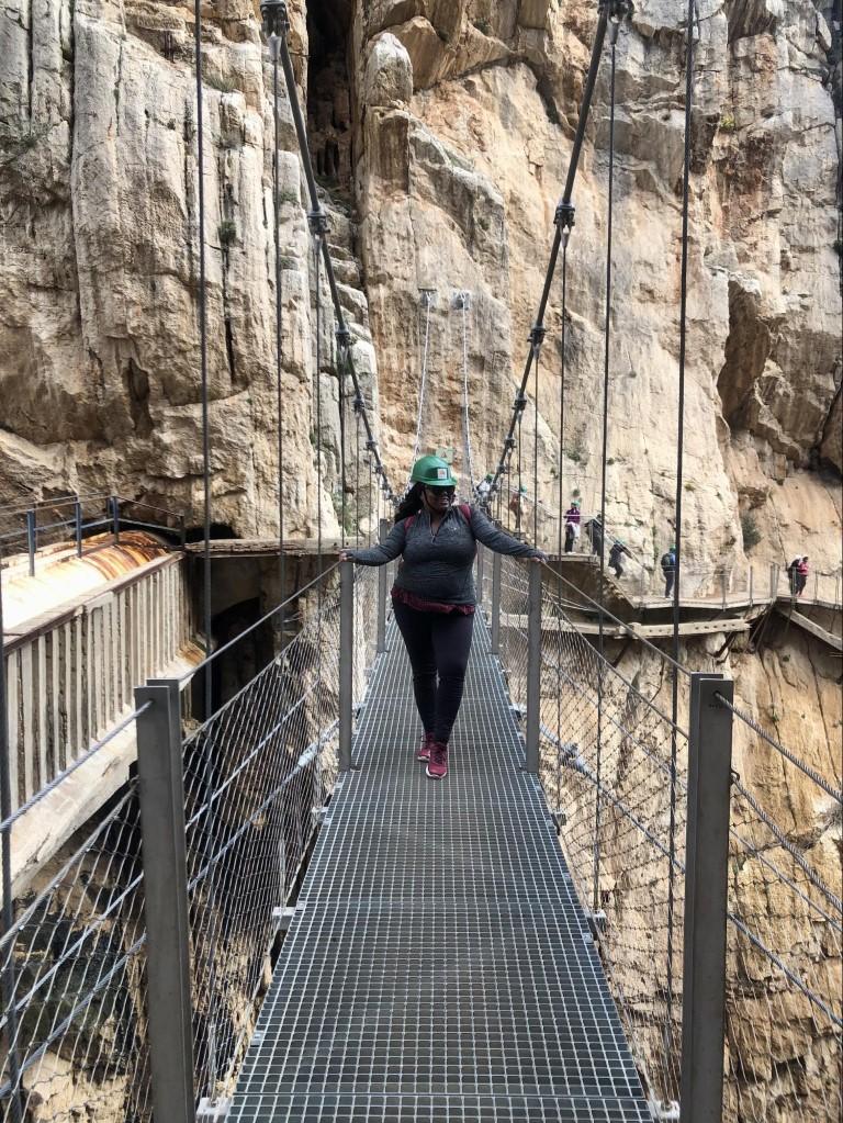 Woman crossing a bridge on the Caminito del Rey