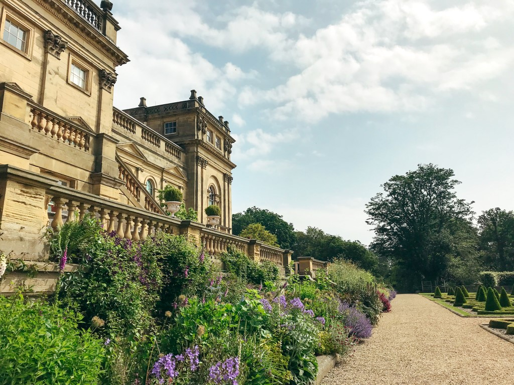 A picture of the front path to the Harewood house with the house on one side and the gardens on the other