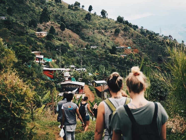 A group of foreigners on a hike in a rural community outside of Medellin