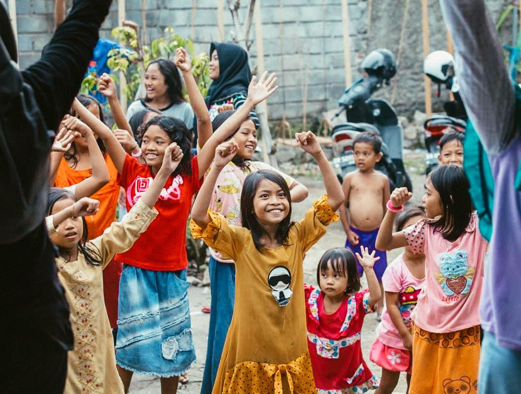 young children dancing at a Nomads Giving Back! volunteer event in Bali, Indonesia