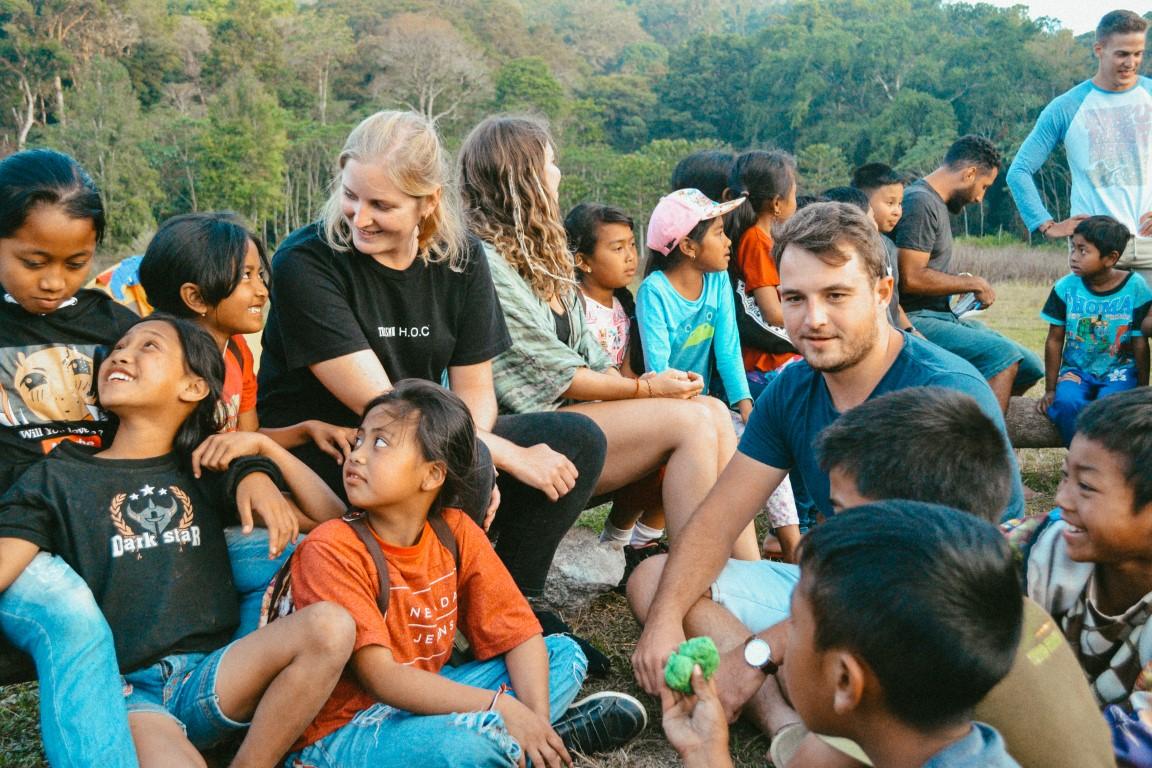 A group of Nomads Giving Back! volunteers hosting a language exchange program