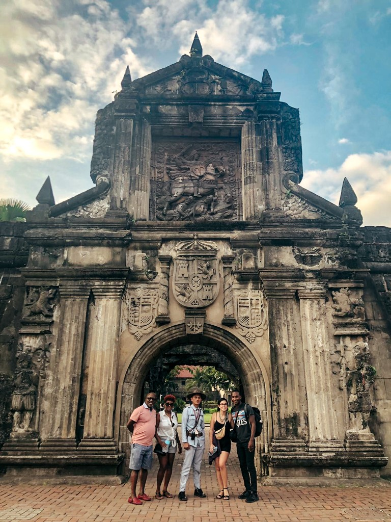An American family with a tour guide taking a tour of Intramuros in Manila