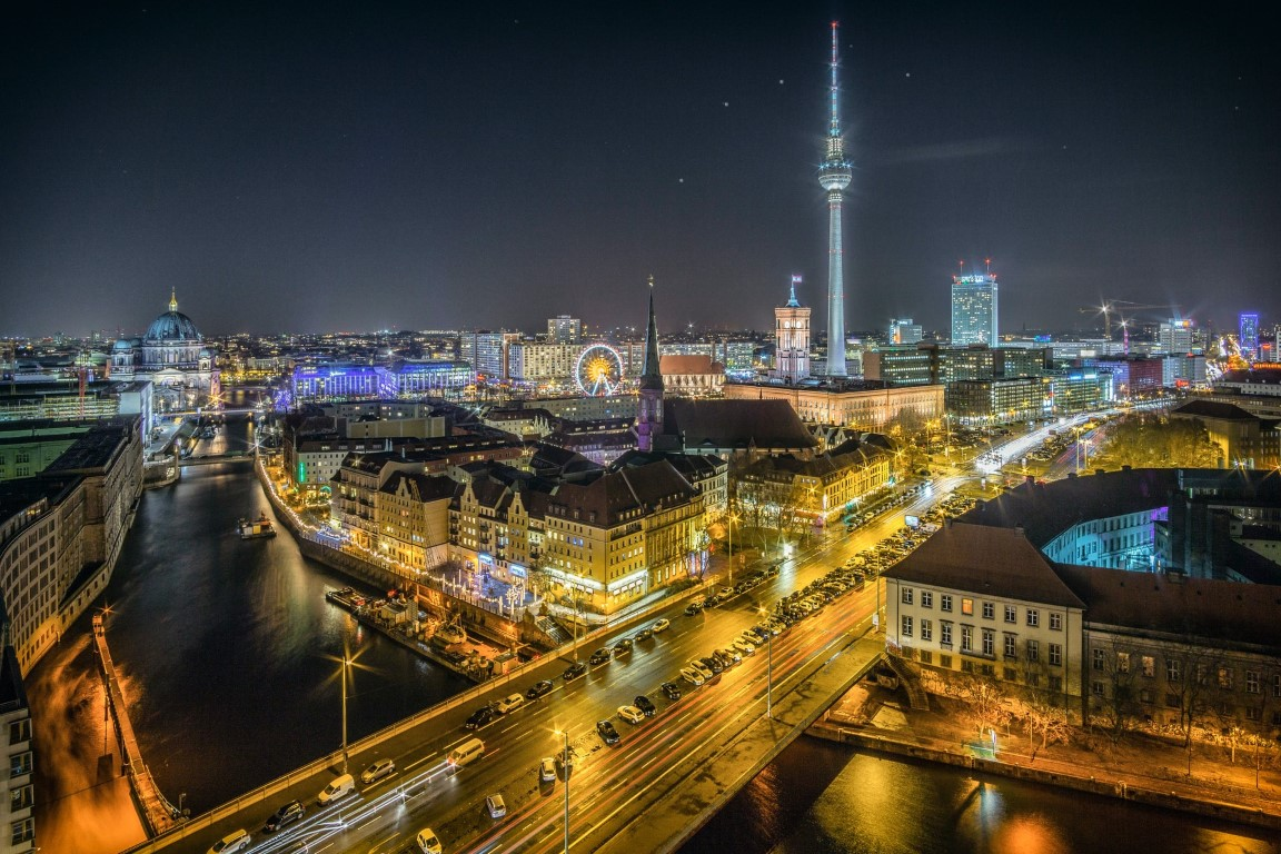 A nighttime view of Berlin's skyline on a clear night with the building illuminated