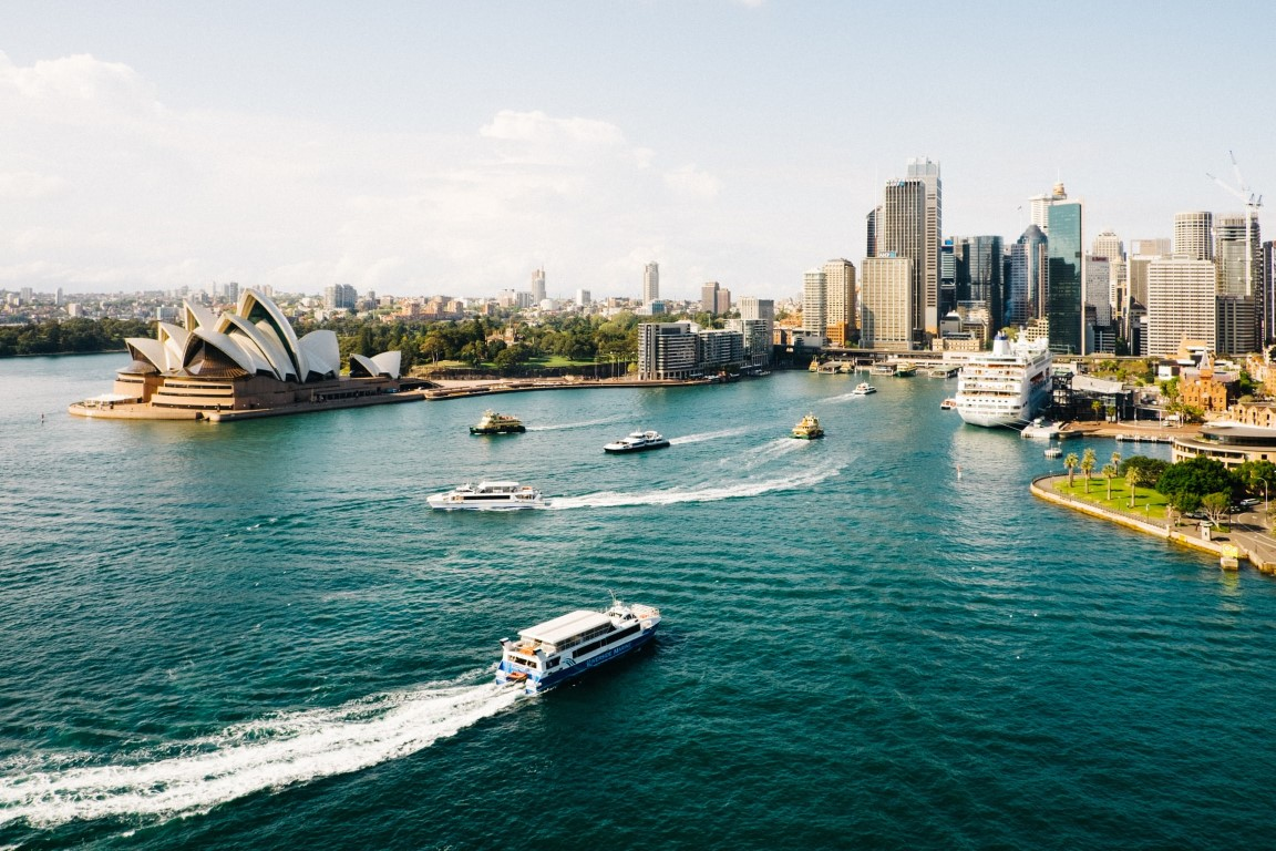 A view of the Sydney harbor from the water on a clear, sunny day