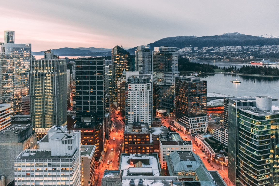 Vancouver, Canada skyline at dusk with snow on the ground in winter