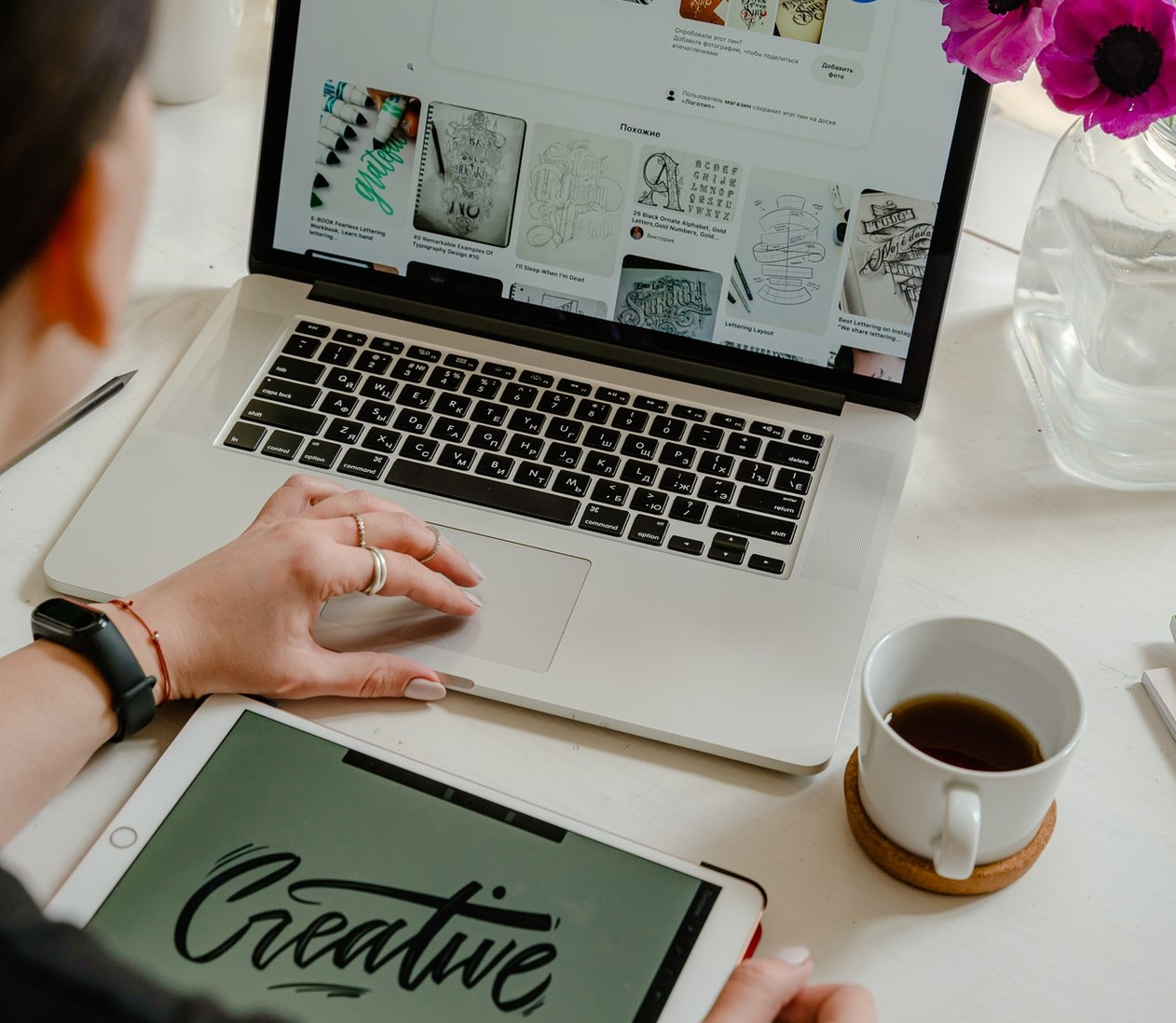 A graphic designer getting inspiration for a new project on Pinterest