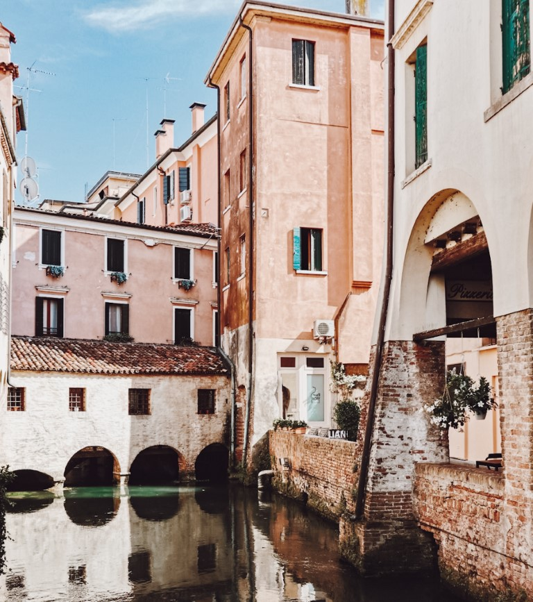 Beautiful corner in Treviso, Northern Italy with pastel colored houses and canals running underneath