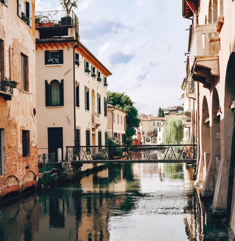 The canal streets in Treviso Italy with beautiful houses and patios on either side