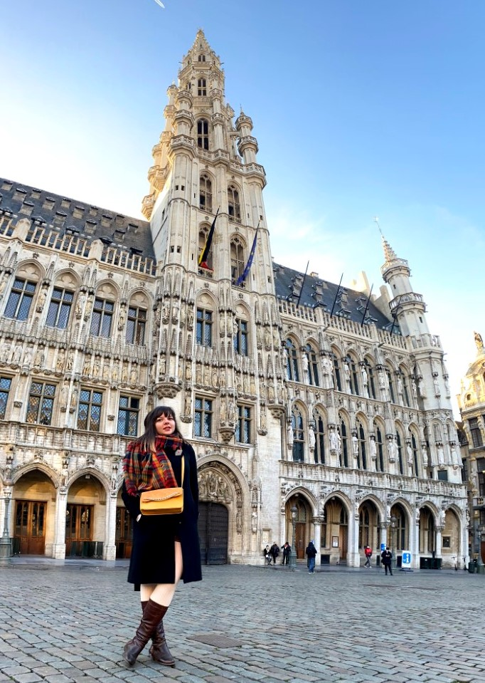 A foreign woman living in Brussels standing in front of an EU building