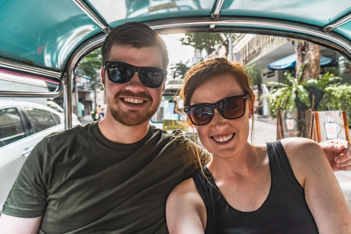 Two foreign teachers from South Africa living and working in Malaysia taking a selfie in the back of an open air taxi