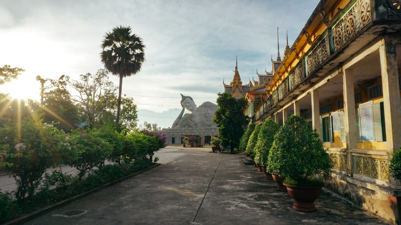 A view of the laying down buddle and Wat Patum temple in Soc Trang, Vietnam at sunset