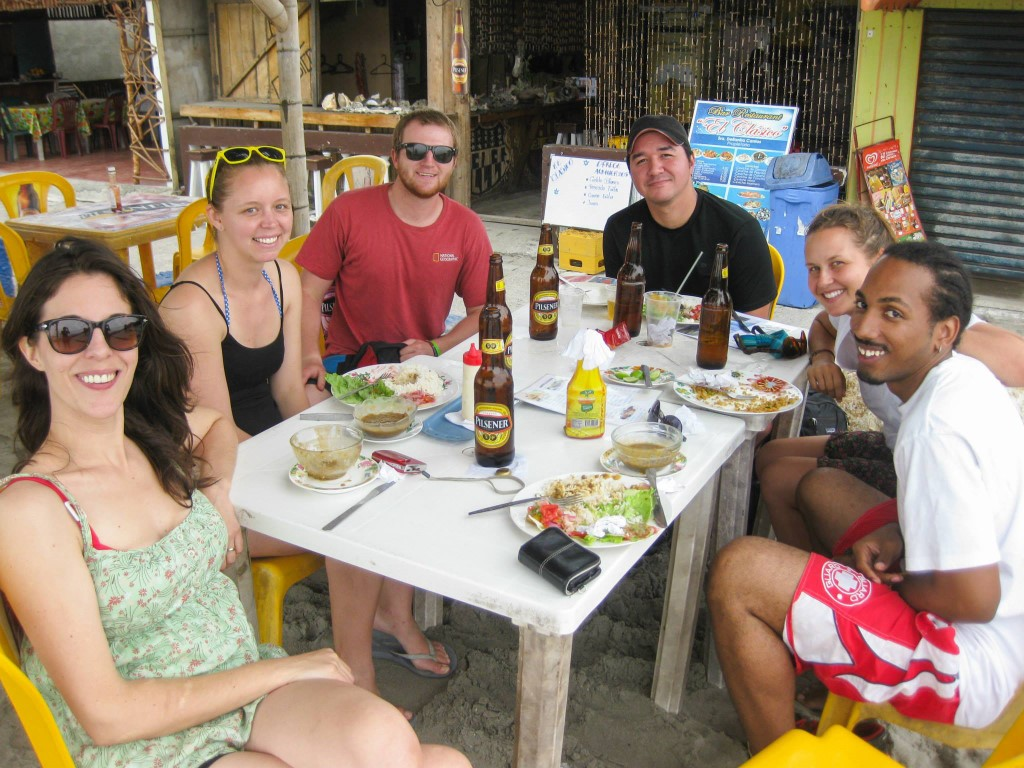 a group of Peace Corps volunteers eating lunch on the beach in Machala, Ecuador