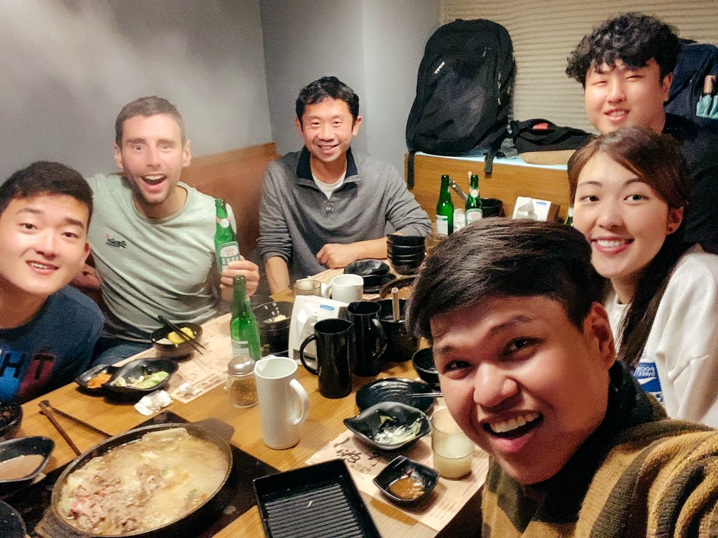 A group of students studying Chinese in Taiwan all eating and drinking together on a night after class